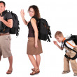 Young woman with backpack has lifted hand in greeting — Stock Photo #7443669