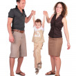 Father with mother have lifted the son for hands — Stock Photo #7443682
