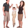 Father with mother have lifted the son for hands — Stock Photo