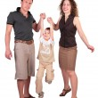 Mother with father have lifted son for hands — Stock Photo