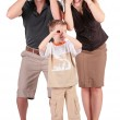 Father, son and mother look in field-glasses from hands — Stock Photo