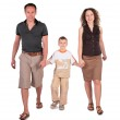Father, son and mother go having joined hands — Stock Photo