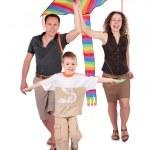 Parents and son start kite — Stock Photo