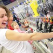 Young woman in shop plays with joystick — Stock Photo #7443919