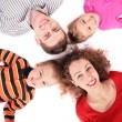 Family of four lying on floor - Stock Photo
