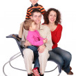 Family of four sits on chair - Stock Photo