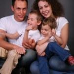 Portrait of family on dark background — Stock Photo