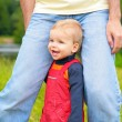 Child at legs of father - Stock Photo
