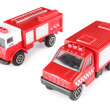 Stock Photo: Two toy fire machines