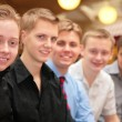 Five young men indoor — Stock Photo