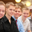 Stock Photo: Five young men indoor
