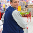Man in supermarket with shopping cart — Stock Photo #7445276