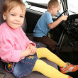 Girl and boy in car — Stock Photo