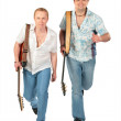 Two running men with guitars — Stock Photo