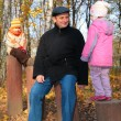 Grand-dad with grandsons in forest in autumn — Stock Photo #7445403