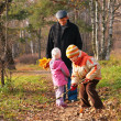 Grand-dad with grandsons in forest in autumn — Stock Photo #7445406