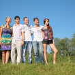Group of friends outdoor in summer — Stock Photo