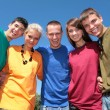 Group of friends in multicolor  shirts - Stockfoto