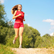Stock Photo: Young girl runs in forest
