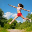 Young woman doing exercise in park — Stock Photo