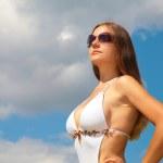 Girl in sunglasses against sky — Stock Photo