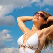 Girl in bathing suit and sunglasses — Stock Photo
