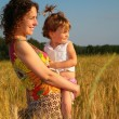 Royalty-Free Stock Photo: Mother with  child on  wheaten field