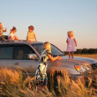 Parents and children on offroad car on wheaten field — Stock Photo #7445905