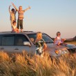 Parents and children on offroad car on wheaten field — Stock Photo #7445907