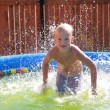 Boy in pool — Stock Photo #7445928