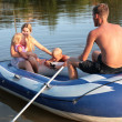Family in an inflatable boat — Stock Photo
