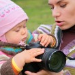 Mother holds baby with camera — Stock Photo #7446110