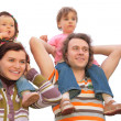 Stock Photo: Parents with children on shoulders