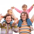 Parents with children on shoulders — Stockfoto