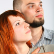 Young man and red hair woman - Stock Photo