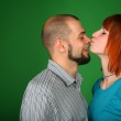 Girl with red hair kisses guy on nose — Stock Photo #7446409