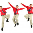 Contented dynamic businessman in red shirt jumps — Stock Photo