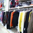 Clothes on rack in shop — ストック写真