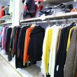 Clothes on rack in shop — Stock fotografie