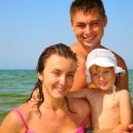 Family pose in sea — Stock Photo