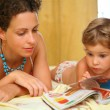 Mother and child read magazine — Stock Photo