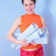 Young woman with rolls of wall-paper — Stock Photo #7447141