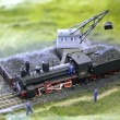 Model of steam locomotive is loaded by coal — Stock Photo