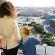 Mother and two children looks on St.Petersburg — Stock Photo