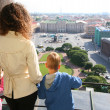Mother and two children looks on St.Petersburg — Stock Photo #7447324