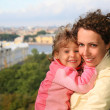 Mother with child against St.Petersburg — Stock Photo #7447338