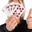 Woman holds cards in  hand  and does gesture by  thumb — Stock Photo