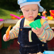 Little child plays in sandbox — Stock Photo