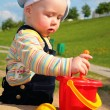 Child play in sandbox — Stock Photo