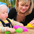 Mother and child in sandbox — Stock Photo